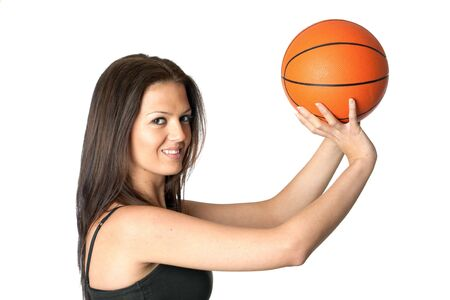 hand baskets: Attractive girl shooting basketball isolated on white background Stock Photo