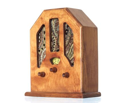 Beautiful old wooden radio on a over white background photo