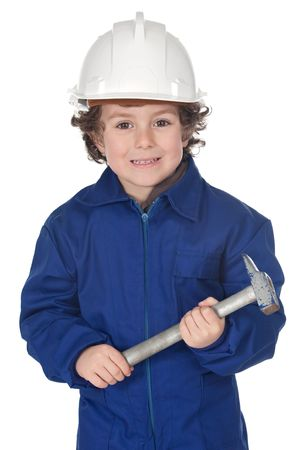 Adorable worker child with a hammer and helmet on a over white background photo