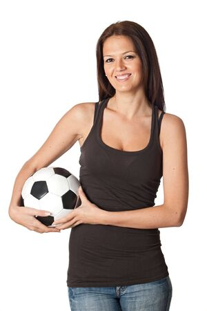 Attractive young woman with soccer ball isolated on a over white background photo