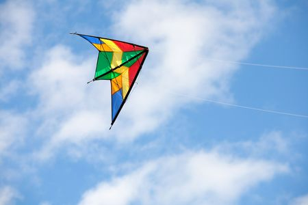 Nice kite flying colors against the blue sky Stock Photo - 6862817