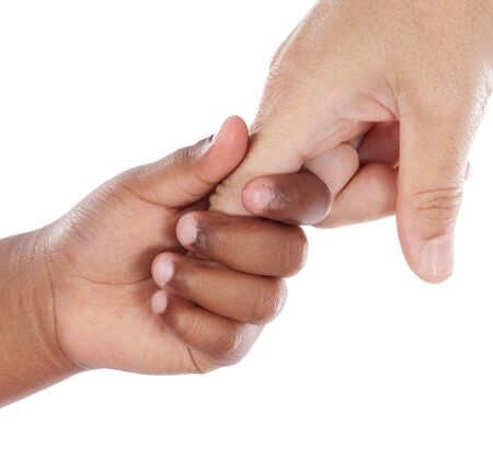 Handshake between an African-American and Caucasian isolated on white background photo