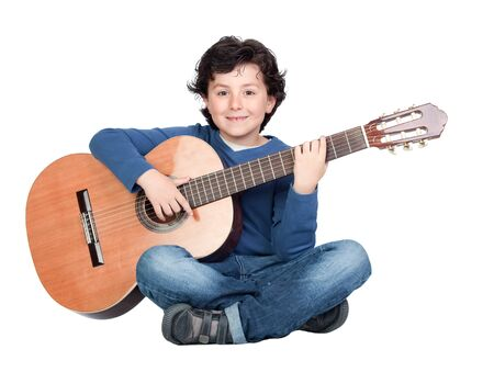 Music student playing the guitar isolated on a over white background photo