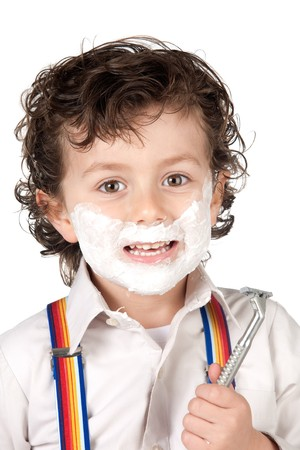 Adorable child shaving over a white background photo