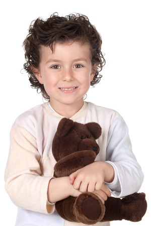Pretty boy in pajamas with teddy bear isolated on white background photo
