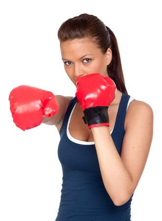 Attractive girl practicing boxing isolated on white background photo