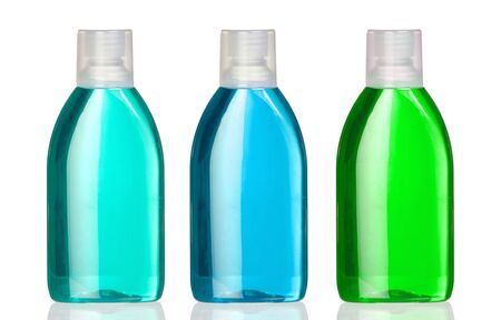 mouthwash: Three bottles of mouthwash with reflection on white background