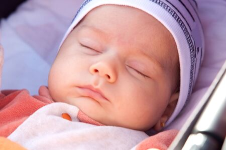 tranquillity: Beautiful baby girl sleeping with cap on his head