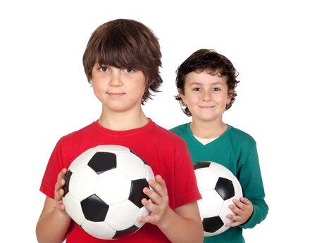 hermanos jugando: Dos ni�os adorable con bolas sobre un fondo blanco