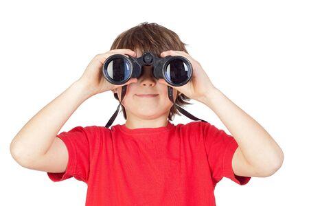 Little boy looking through binoculars isolated on white background photo