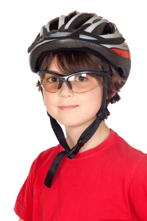 Funny child with glasses and a bicycle helmet isolated on white background photo