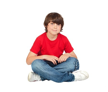 beautiful bangs: Adorable child sitting on the floor isolated on white background