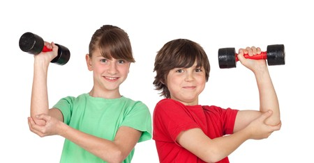 strong growth: Two children playing sports with weights isolated on white background