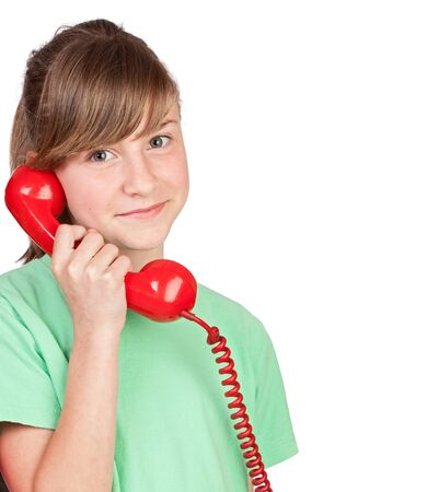 Preteen girl with red telephone on a over white background photo