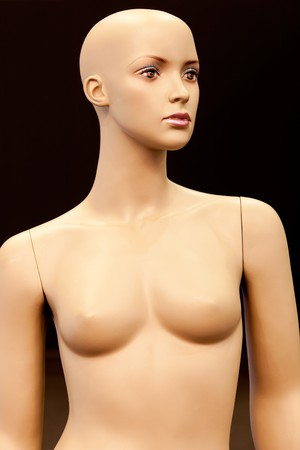 woman chest: Bald girl mannequin isolated on black background Stock Photo