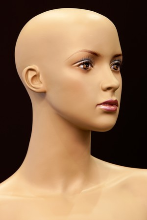 mannequin head: Face of girl mannequin isolated on black background