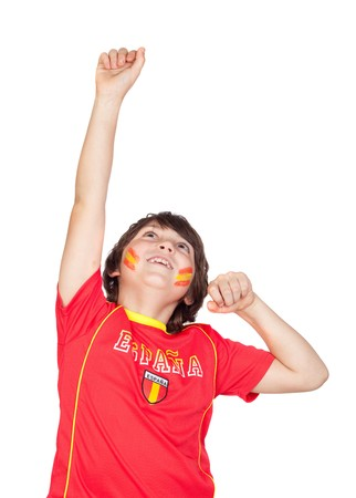 preteen boy: Winner child fan of the Spanish team celebrating a goal isolated on white background