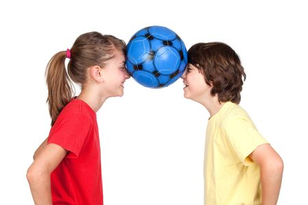 Children holding a ball with their foreheads isolated on white background photo