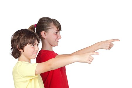 Adorable preteen girl and little boy finger pointing isolated on white background photo