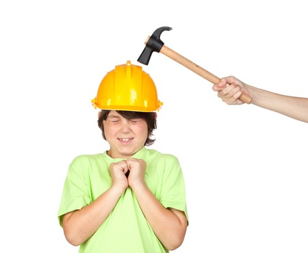 security helmet: Frightened child with yellow helmet and hammer over a white background