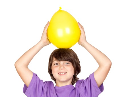 Funny kid with a yellow balloon isolated on a white background photo