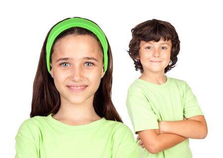preteens girl: Couple of children with same clothes isolated on white background Stock Photo