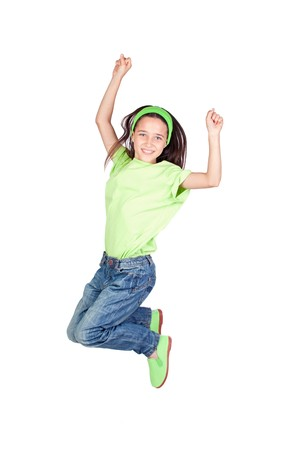 Happy little girl jumping isolated on white background photo