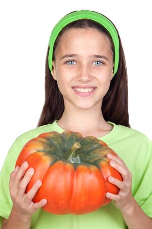 Happy girl in Halloween with a big pumpkin isolated on white background Stock Photo - 7412830