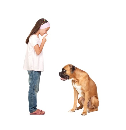 Adorable girl ordering silence his dog isolated on white background photo