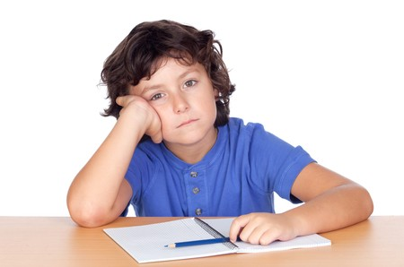 Sad small student isolated on a over white background photo