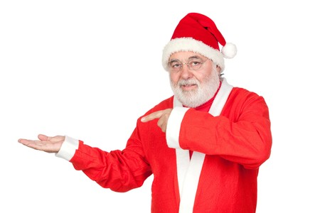 Santa Claus pointing to the outstretched palm of your hand on white background photo