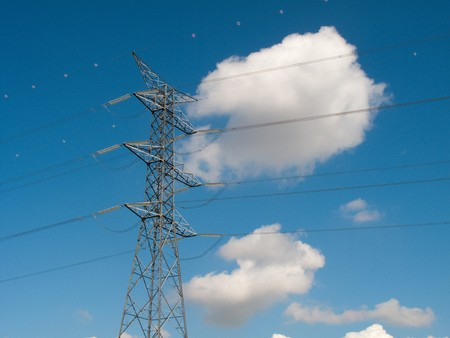 standalone: Power lines under a pretty blue sky Stock Photo