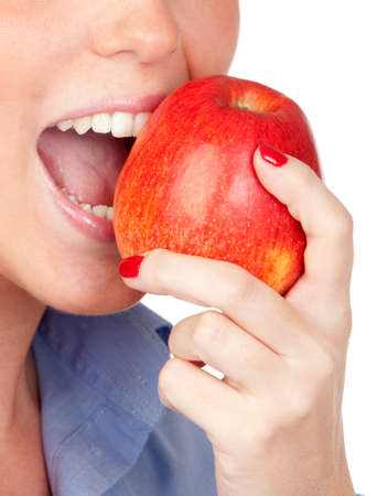 Pretty girls mouth biting an apple isolated on a over white background photo