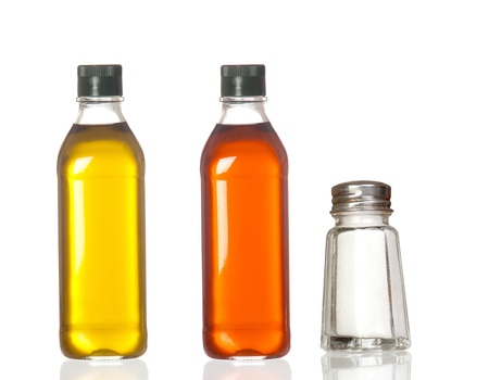 vinegar: Bottles of oil, vinegar and salt boat isolated on white background