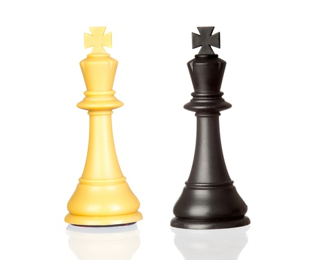 chess king: The white and black king isolated on white background