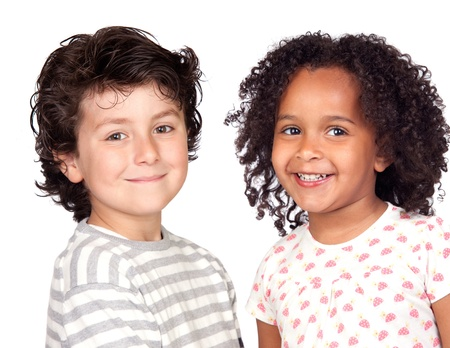 Two beautiful children isolated on a over white background photo
