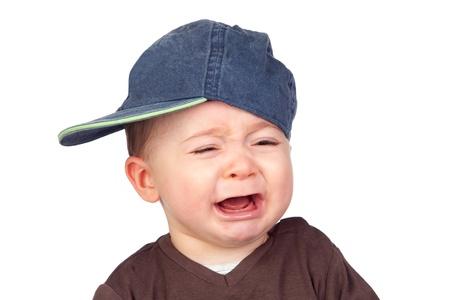 tantrums: Bel bambino piangere con un tappo isolato su sfondo bianco Archivio Fotografico