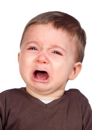ni�os tristes: Hermoso beb� llorando aislado sobre fondo blanco Foto de archivo