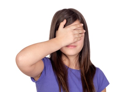 blind people: Adorable preteen covering her eyes on a white background