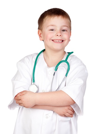 the medic: Adorable child with doctor uniform isolated on white Stock Photo