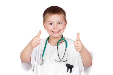 professions: Adorable child with doctor uniform saying Ok isolated on white