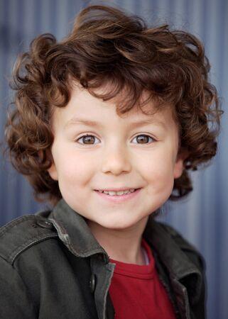 Beautiful boy with nice eyes isolated on white background photo