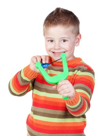 misbehave: Adorable child with a slingshot isolated on white background