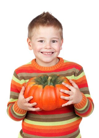 Adorable child with a big pumpkin isolated on white background