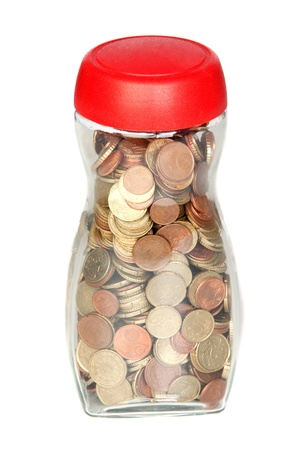 Glass bottle full of coins isolated on white background photo