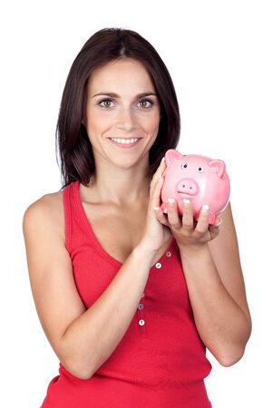 Beautiful girl with piggy-bank isolated on a over white background photo