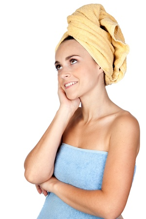 Pensive girl with towel isolated on a over white background photo