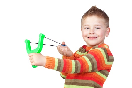 rascal: Adorable child with a slingshot isolated on white background