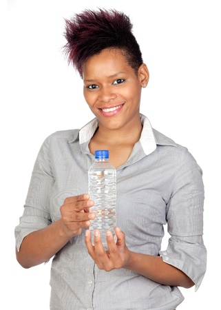 Exotic african girl with a water bottle isolated on white background photo