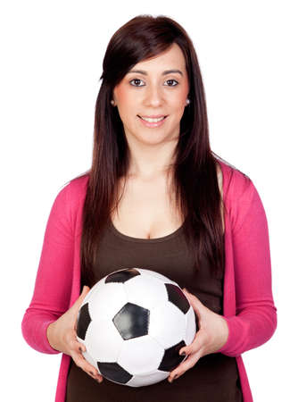 Beautiful brunette girl with soccer ball isolated on a over white background photo